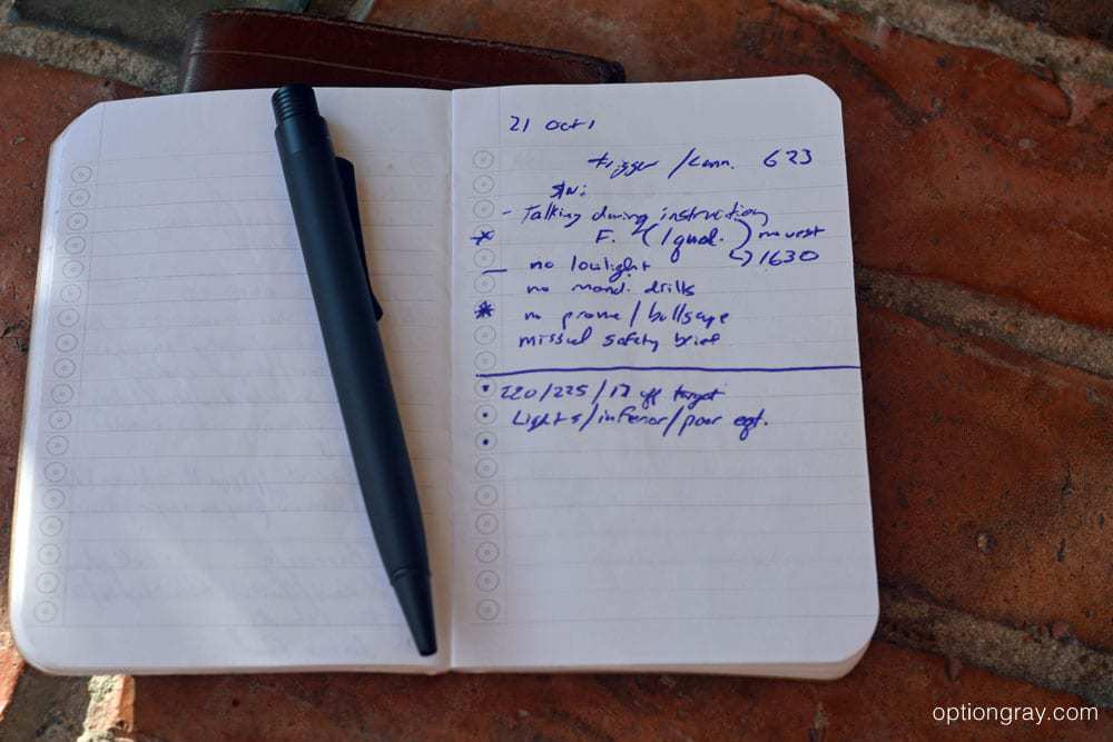 pen and notebook with notes