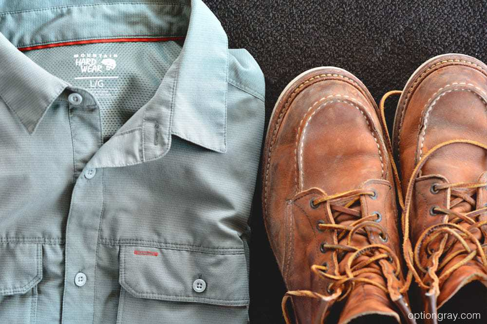 gray man clothing including a mountain hardwear shirt and redwing boots.