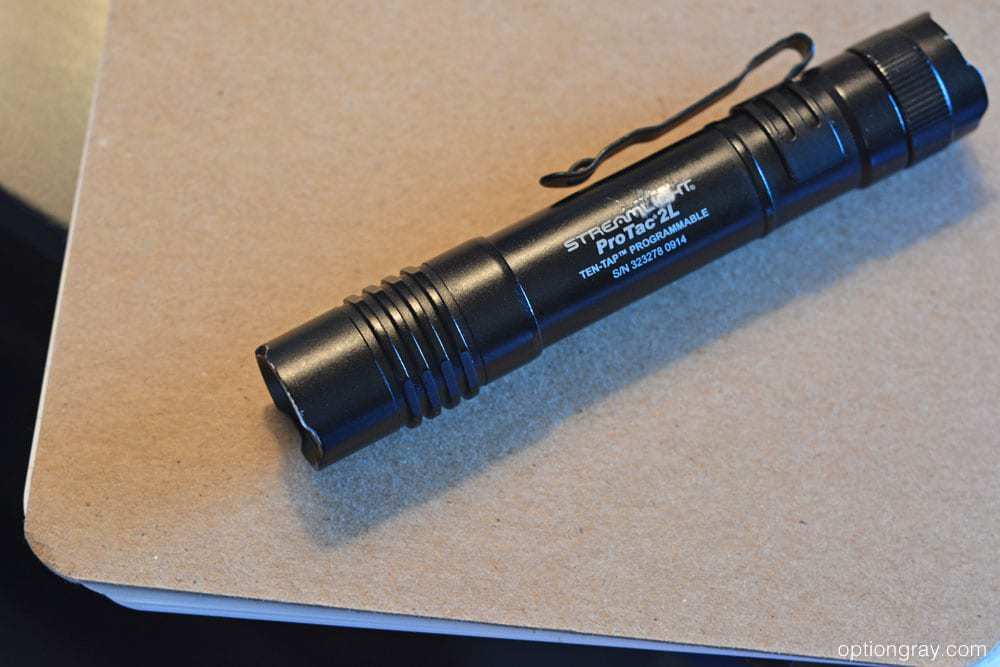 streamlight protac 2l flashlight on a nightstand