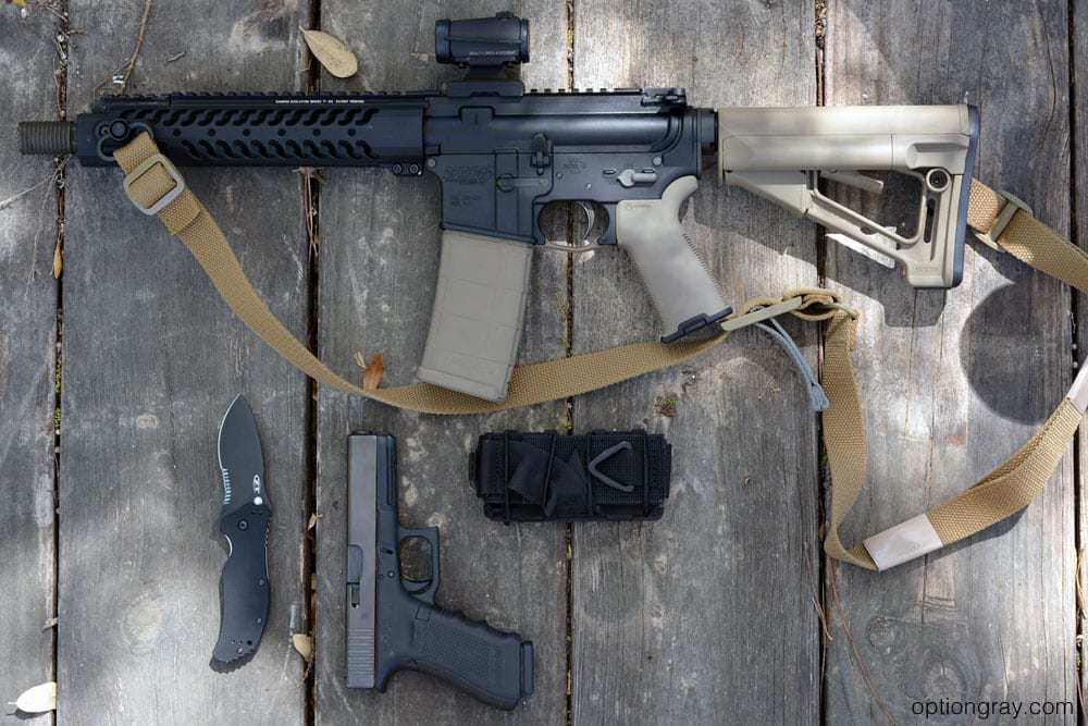 Short barrel AR15, PHLster Flatpack Tourniquet Carrier, Tactical Medical Solutions SOF Tactical Tourniquet, and the Zero Tolerance 0350ST.