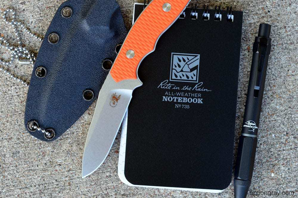 """Hinderer Knives Flashpoint 3"""" Neck Knife, the Fisher Space Pen Clutch Pen, and the Rite in the Rain 3"""" x 5"""" Top Spiral Notebook"""