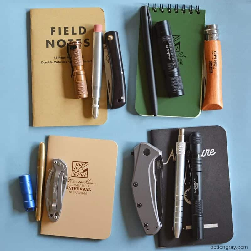 A variety of everyday carry basics, including: notebooks, knives, pens, pencils, and flashlights.