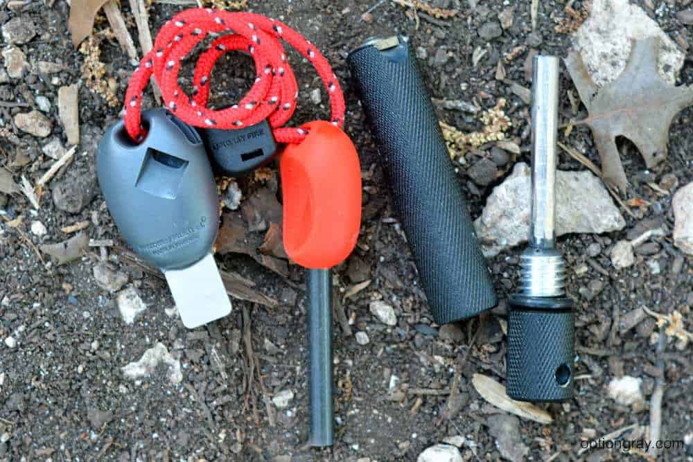 Light My Fire Swedish FireSteel 2.0 Scout in red and Solo Scientific's Aurora Fire Starter in black.