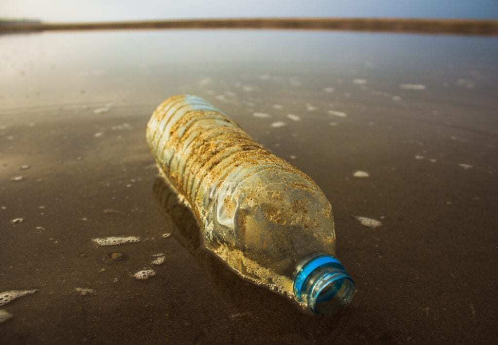 polluted water and water bottle